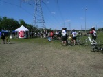 hundreds of riders make their way to the loading area that will take them to the finish line.